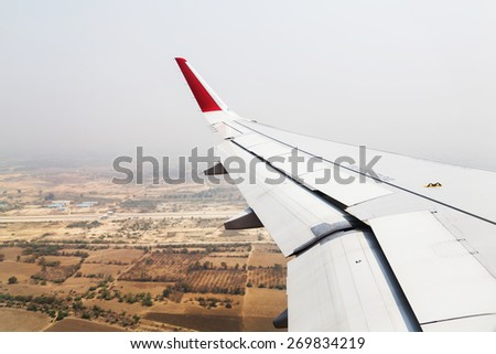 Aircraft landing in Mandalay Airport., flying background Myanmar. - stock photo