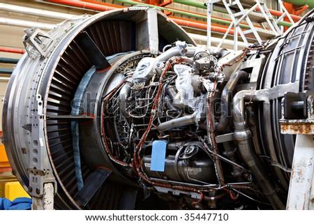 Aircraft maintenance, dismantled plane engine - stock photo