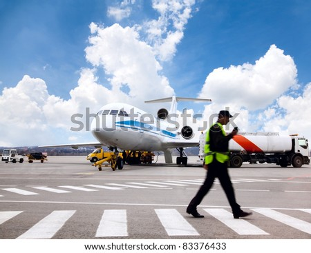 Aircraft maintenance people during refueling - stock photo