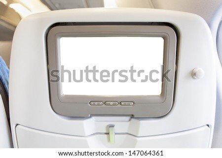 Aircraft monitor in passenger seat isolated on white background  - stock photo