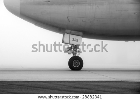 Aircraft on foggy runway waiting for takeoff - stock photo