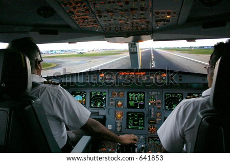 aircraft on runway viewed from cockpit - stock photo