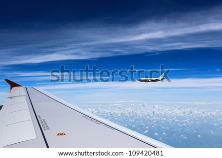 aircraft on the clouds with the blue sky