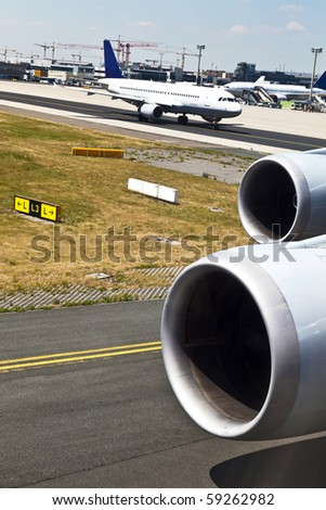 aircraft on the way to the runway - stock photo