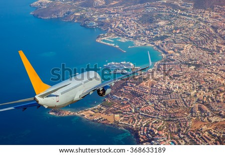aircraft over the city - stock photo
