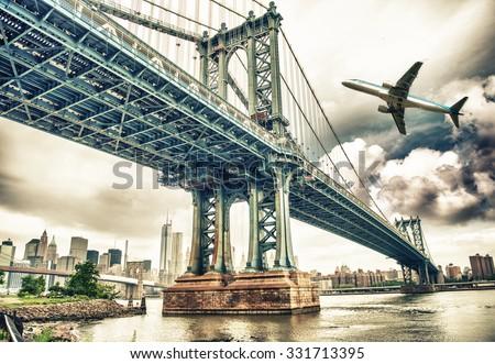 Aircraft overflying New York City skyline. - stock photo