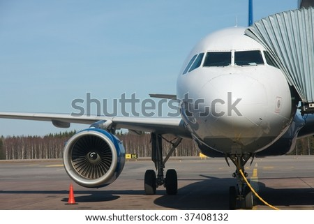 Aircraft parked in the terminal - stock photo