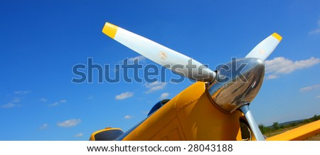 Aircraft propeller against a blue sky - stock photo