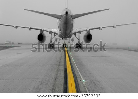 aircraft taking off on foggy runway - stock photo