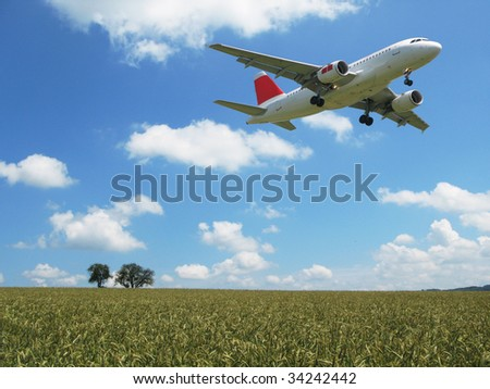 Aircraft taking off over a scenic wheat field