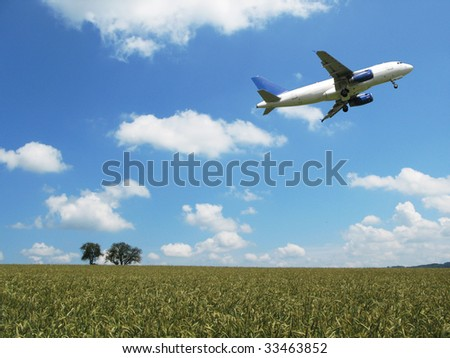 Aircraft taking off over a wheat field