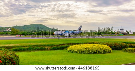 Aircraft taxi in a natural environment. The Bangkok Airways A320 taxiing on the runway at Samui airport, which is decorated like an outdoor park in Samui Island, Thailand on Jul 26, 2016 - stock photo
