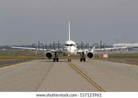 Aircraft taxiing on the runway - stock photo