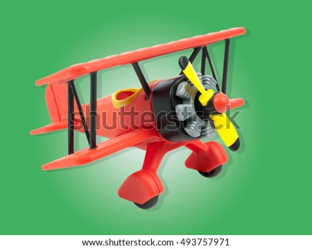 Aircraft toy isolated on green background