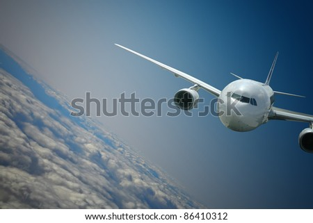 Aircraft turning above the clouds - stock photo