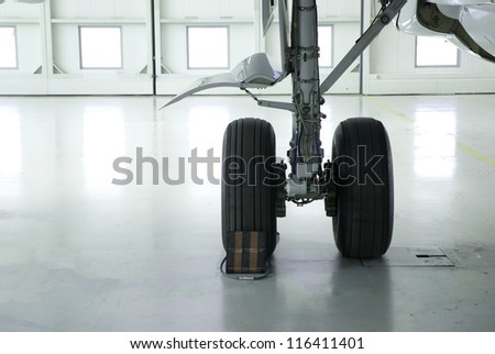Aircraft undercarriage in hangar - stock photo