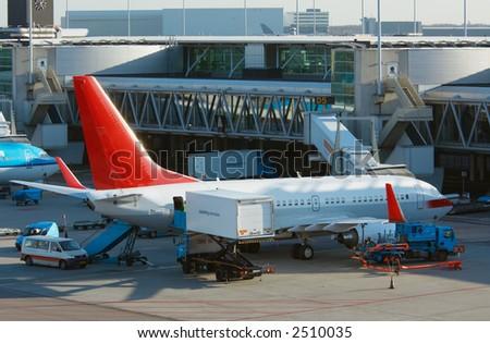 aircraft unloading cargo - stock photo