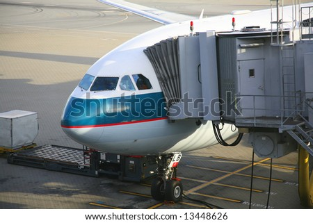 aircraft unloading passengers - stock photo