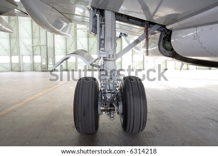aircraft wheel in the hangar, bottom view - stock photo