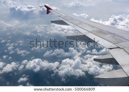 Aircraft wing and clouds.