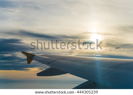 aircraft wing with blue sky background,low key