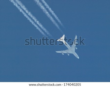 aircraft with contrails - stock photo