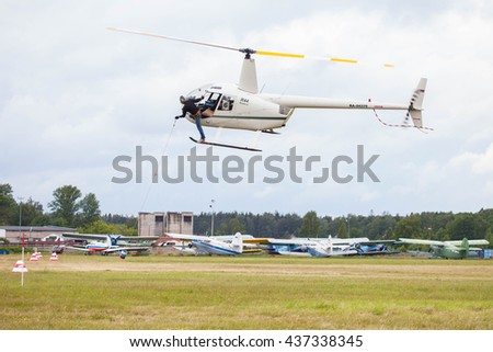 "Airfield ""Black"", MOSCOW REGION, RUSSIA - JUNE 11, 2016: The championship of Russia on helicopter sports. Helicopter Robinson R-44"