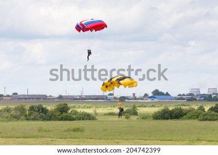 "Airfield Frolovo,Russia - June 29,2014.Festival ""Wings of Parma 2014"".parachutist approaching to land at  festival ""Wings of Parma 2014"" on June 29,2014"