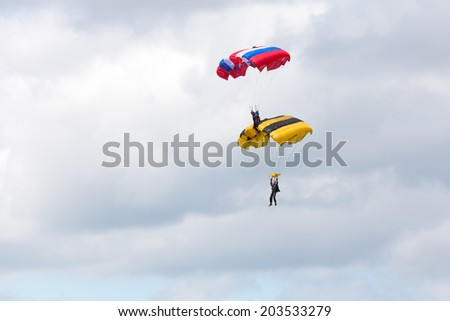 "Airfield Frolovo,Russia - June 29,2014.Festival ""Wings Parma 2014"".air element shelves parachutists in sky"
