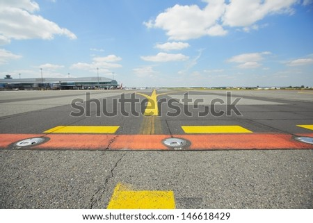 Airfield - marking on taxiway is heading to runway.  - stock photo
