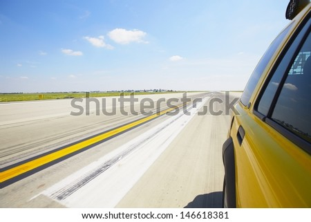 Airfield - safety car on the runway - blurred motion - stock photo