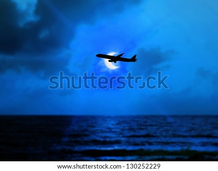 Airline flying in the sky at night. beautiful colored sunset over the sea