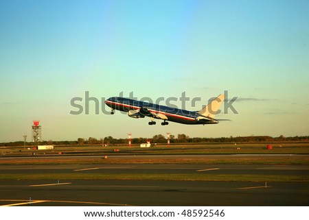 airline jet takeoff at sunset - stock photo