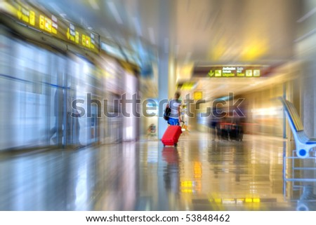 Airline passenger walking in the airport terminal - stock photo