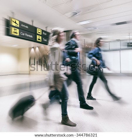 Airline Passengers in a Airport Arriving from a Flight. - stock photo