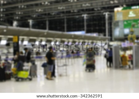 Airline Passengers in an International Airport - stock photo