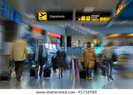 Airline passengers walking in the airport terminal - stock photo