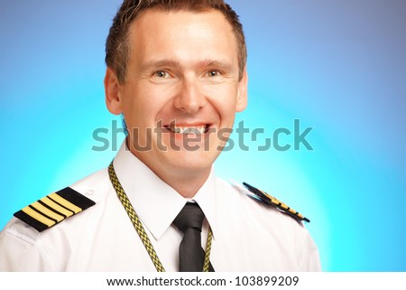 Airline pilot wearing uniform with epaulettes - stock photo