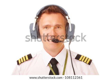 Airline pilot wearing uniform with epaulettes and professional headset. - stock photo