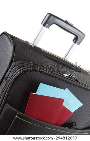 Airline ticket, passport and luggage isolated on white - stock photo