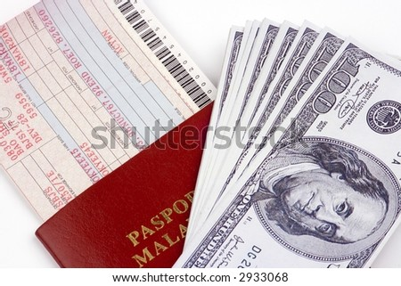 Airline ticket with passport and US Dollar currency.