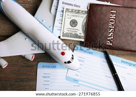 Airline tickets and documents on wooden table, closeup - stock photo