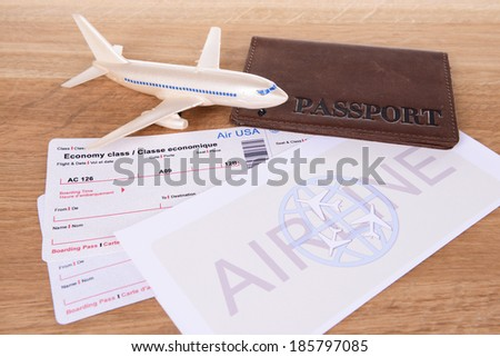 Airline tickets with passport on table close-up - stock photo
