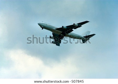 Airliner against an overcast sky - stock photo