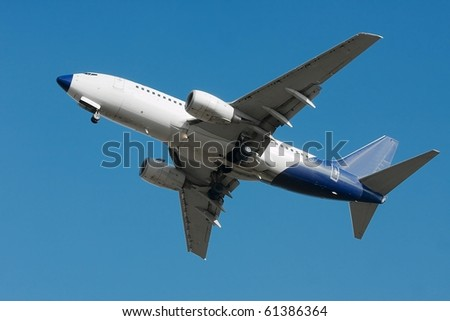 Airliner against clear blue sky - stock photo