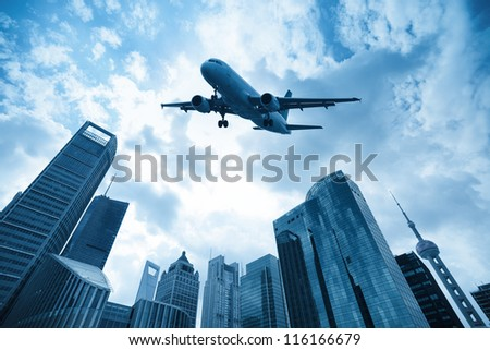 airliner and modern city in shanghai, China - stock photo