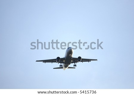 airliner at altitude - stock photo