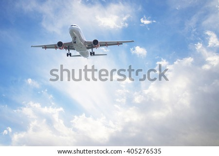 airliner flying in the sky among the clouds