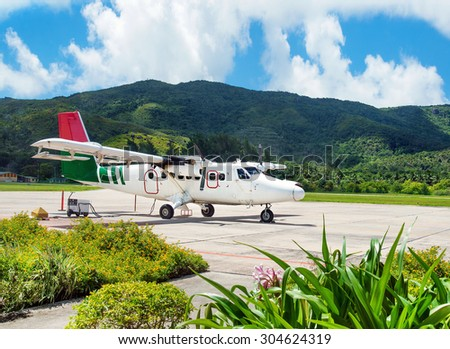 Airliner in Iles des Palmes Airport (IATA: PRI, ICAO: FSPP), Grand Anse, Praslin Island, Seychelles - stock photo