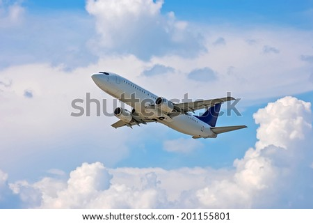 Airliner in the air on cloudscape background - stock photo